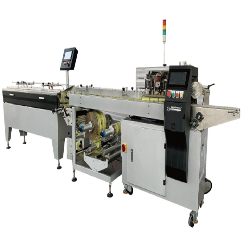 FACIAL MASK PACKING MACHINE HAND TOWEL PACKING MACHINE DISPOSABLE HORIZONTAL PACKING MACHINE Featured Image